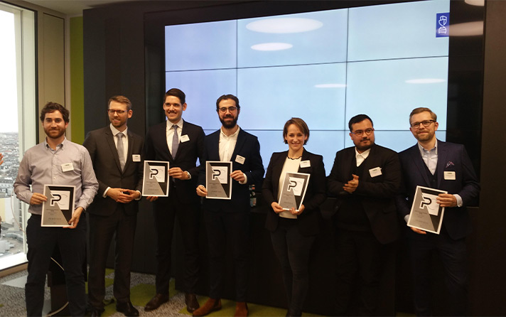 group photo of the cbre proptech challenge winners presenting their awards