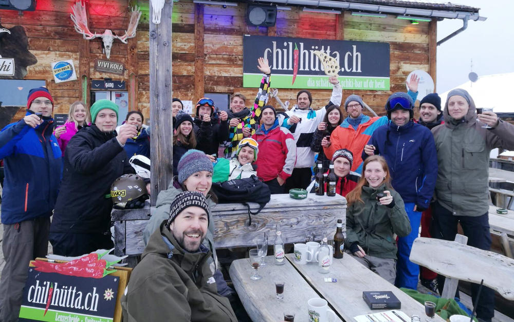 group photo of people in front of chilihütta ski lodge
